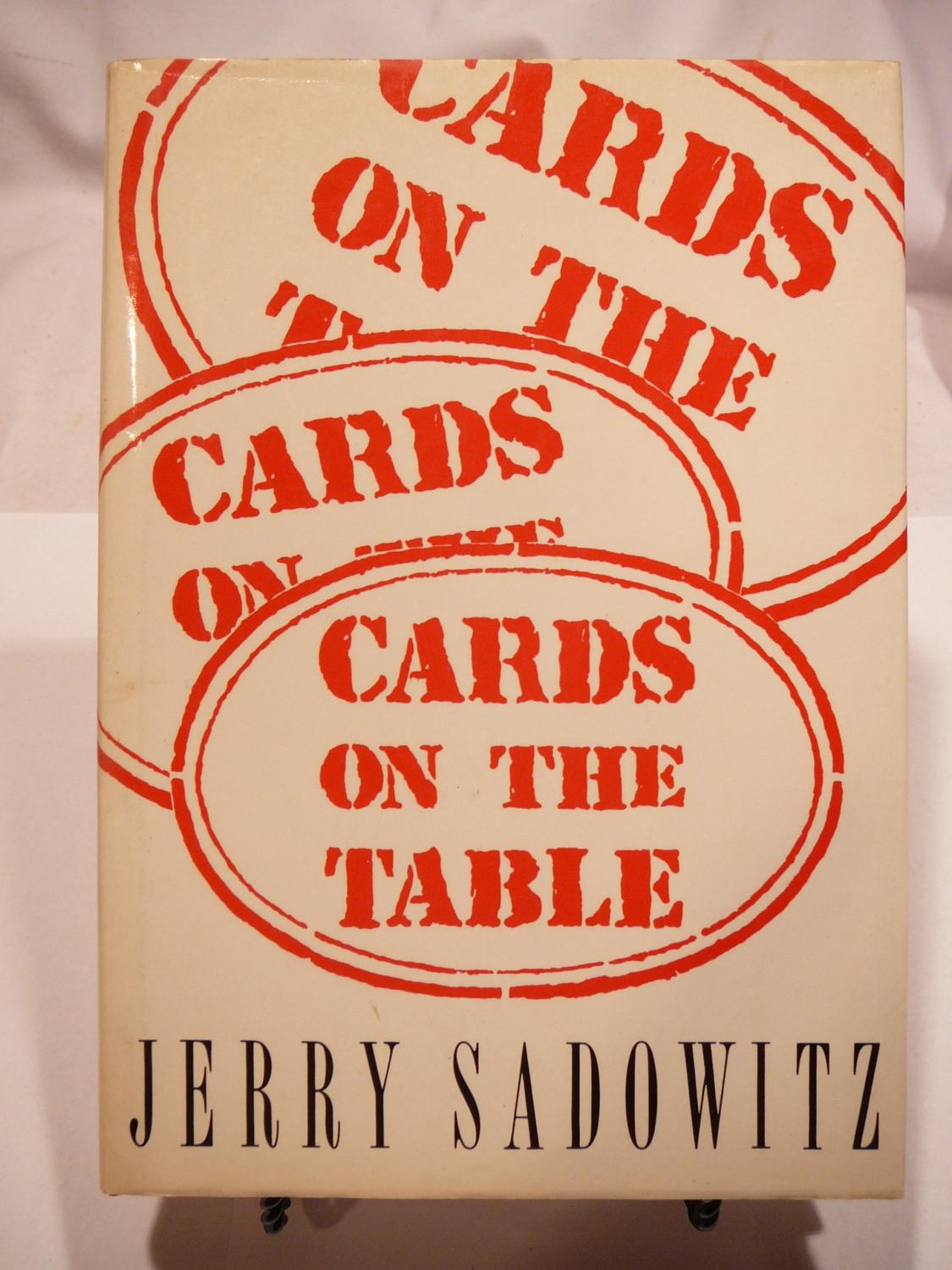 Cards on the Table Sadowitz, Jerry Near Fine Hardcover Book is Mint with no marks or writings, pages bright and clean, binding sound. Dust jacket in very good condition with light shelf wear and very light