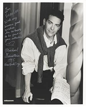 Three-quarter-length photograph of the noted American singer-pianist,: FEINSTEIN, Michael 1956-