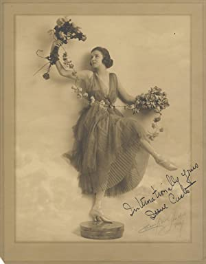 Fine full-length original photograph of the noted ballroom dancer in costume, posed on a pedestal...