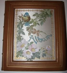 Photo Album with Sunken Inset Silk Panels with Chromolithographic Images of a Bluebird and Wild R...