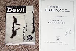 SHAME THE DEVIL - Scarce Fine Copy of The First Hardcover Edition/First Printing: Signed by ...