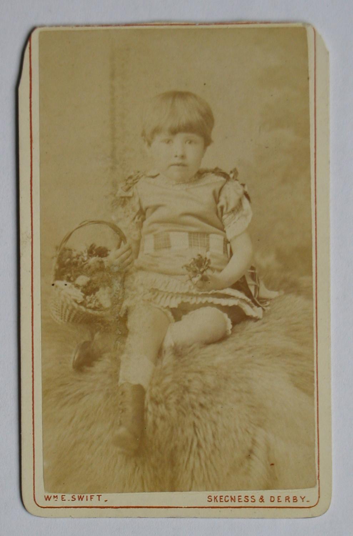 Carte De Visite Photograph Studio Portrait Of A Young Child With Basket Flowers