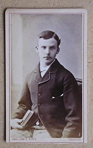 Carte De Visite Photograph. Portrait of a Young Man Holding a Book.: Abel Lewis.