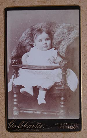 Carte De Visite Photograph. Studio Portrait of a Young Child in a Chair.