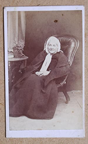 Carte De Visite Photograph. Studio Portrait of an Elderly Woman Seated in a Chair.