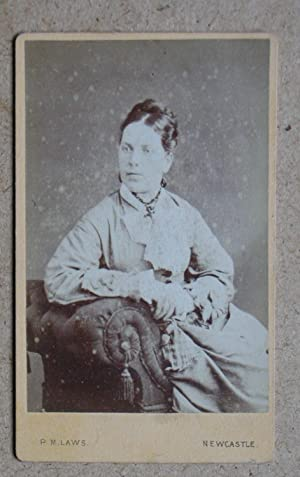 Carte De Visite Photograph. Studio Portrait of a Seated Young Woman.