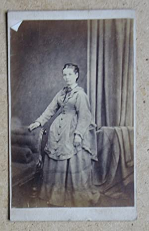 Carte De Visite Photograph. Studio Portrait of a Young Woman in a Hooped Dress.