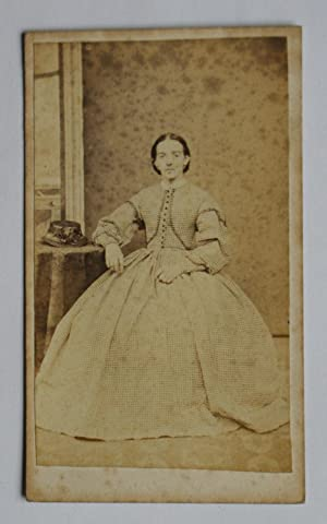 Carte De Visite Photograph. Studio Portrait of a Seated Young Woman Wearing a Hooped Dress.