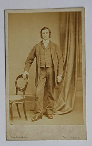 Carte De Visite Photograph. Studio Portrait of a Gentleman Beside a Chair.