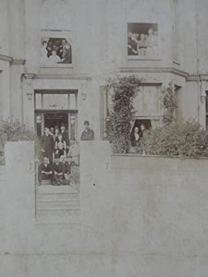Cabinet Photograph: A Group of People In & Outside a House.