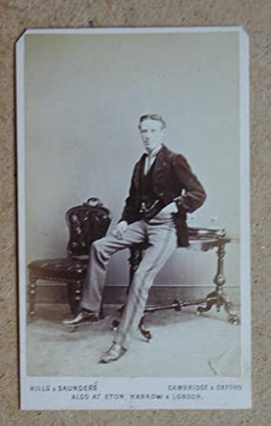 Carte De Visite Photograph: Studio Portrait of a Young Gentleman Seated on a Table.