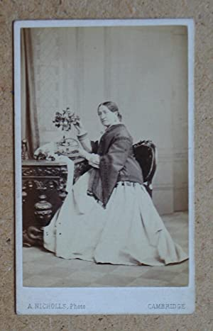 Carte De Visite: Studio Portrait of a Seated Lady with Flowers.