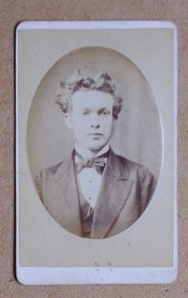 Carte De Visite Photograph: Portrait of a Young Man with a Bow Tie.