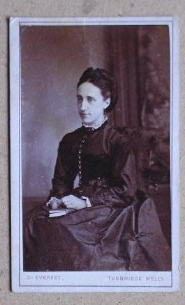 Carte De Visite Photograph: Portrait of a Seated Young Woman with a Book on Her Lap.