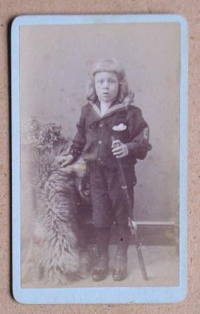 Carte De Visite Photograph: Portrait of a Young Boy in a Sailor Suit Holding a Sword.