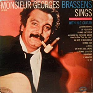 Monsieur Georges Brassens sings with his guitar*: BRASSENS Georges :