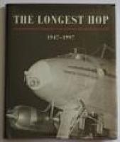 THE LONGEST HOP. Celebrating 50 Years of the Qantas Kangaroo Route 1947-1997: STACKHOUSE, John.