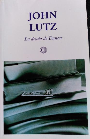 LA DEUDA DE DANCER. - LUTZ, John.