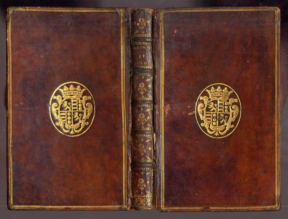 Les Amours Pastorales de Daphnis et Chloé Longus Good Hardcover Full contemporary calf, front board detached with the gilt arms of Carre de Saumery on both boards. Scattered foxing. An attractive edition with an ex
