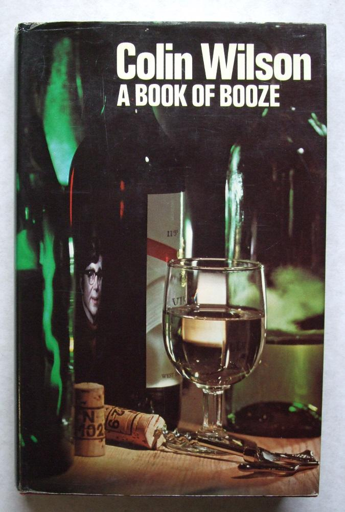 A Book of Booze Wilson, Colin [ ] [Couverture rigide] Hardcover, maroon cloth boards, gilt titles, photographic wrapper, 8vo, 8¾ by 5½ inches, 207pp. First Edition of Wilson's book about wines, and to a lesser extent, spirits and beers. Signed by author, with dedication to Kay and Dennis (Hocking). Dennis Hocking was the coroner and police scientific adviser who worked with WIlson on many of his books. Pages very lightly tanned, spotted to the top edge of the block, binding tight, boards clean, wrapper unclipped, complete but a little cracked at the edges, now in loose protector. A nice association copy. Book is near VG in a near VG wrapper
