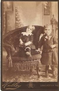CABINET CARD PHOTO OF A TODDLER IN AN ELABORATE VICTORIAN CHAIR, AND A STANDING YOUNG BOY:; Handw...