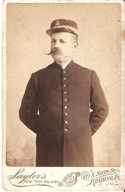 CABINET CARD PHOTO OF CONDUCTOR IN UNIFORM AND HAT WITH BRAID AND COMPANY BADGE:; Charles A. Sayl...
