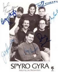 SIGNED, PROFESSIONAL PHOTOGRAPH, AUTOGRAPHED BY ALL SIX MEMBERS OF THIS GROUP