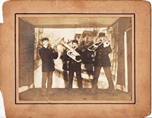 GROUP PHOTOGRAPH OF THE THREE MEMBERS OF THIS UNUSUAL BRASS BAND, COMPRISING CORNET, TUBA, AND SL...