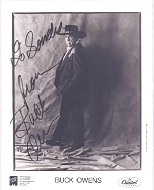 PROFESSIONAL, SIGNED PHOTOGRAPH OF BUCK OWENS:; in elaborate western suit, hat and boots