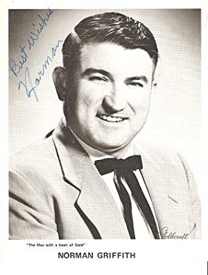 SIGNED, PROFESSIONAL PHOTOGRAPH OF NORMAN GRIFFITH: American country entertainer,
