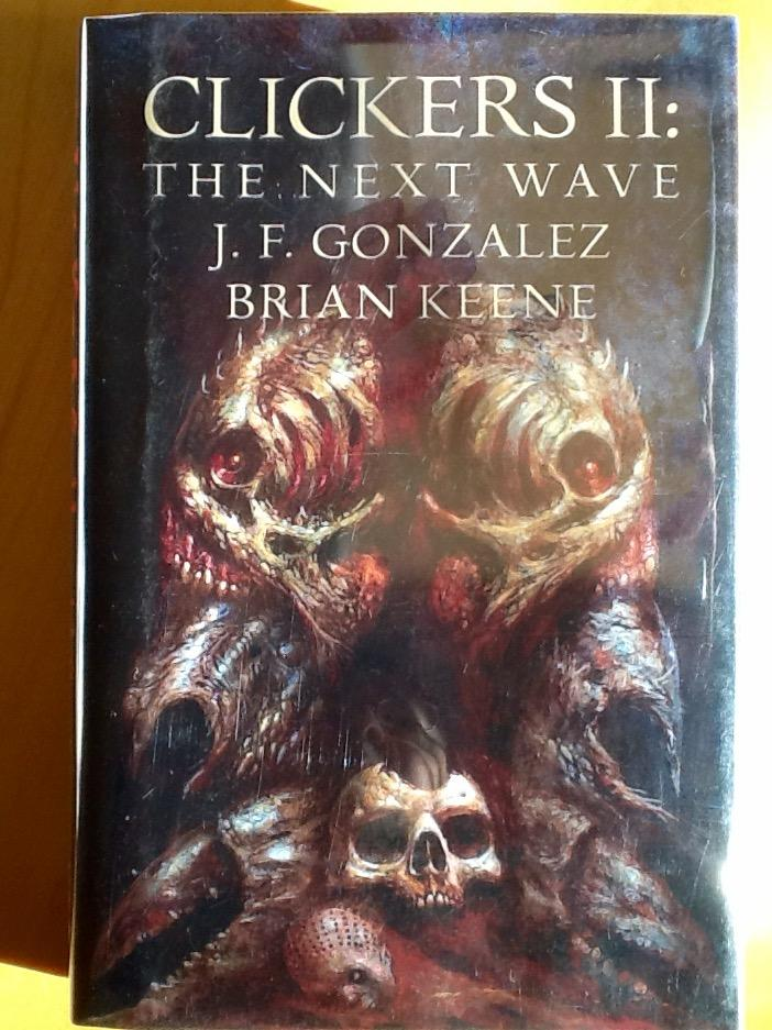CLICKERS II : The NEXT WAVE (Signed & Numbered Ltd. Hardcover Edition) GONZALEZ, J.F. : KEENE, BRIAN [Fine] [Hardcover] HB - Signed & Numbered Ltd. Edition # 238 of 500 - FINE/FINE (As New) -  The Clickers are back, wrecking havoc on a United States already demoralized and defenseless thanks to a category five hurricane and a president who rules through religious zealotry. Now, as the death toll climbs into the thousands, two survivors from the original invasion find themselves teamed up with a marine biologist and a mob hitman, and on the run from the Clickers, the Dark Ones, and their own government. And as their enemies close in on all sides, only one thing is certain - if they fail, humanity loses. .