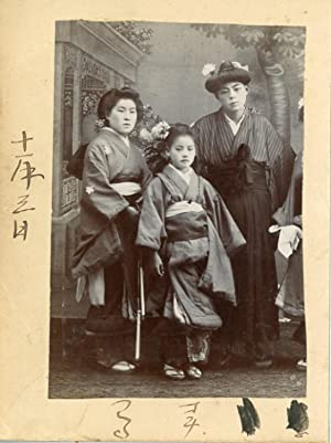 Japan, Photo with Geisha girls and a disguised man
