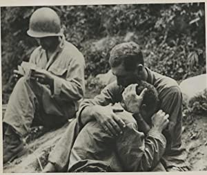 Korea, An American Infantryman morning his buddy killed in action