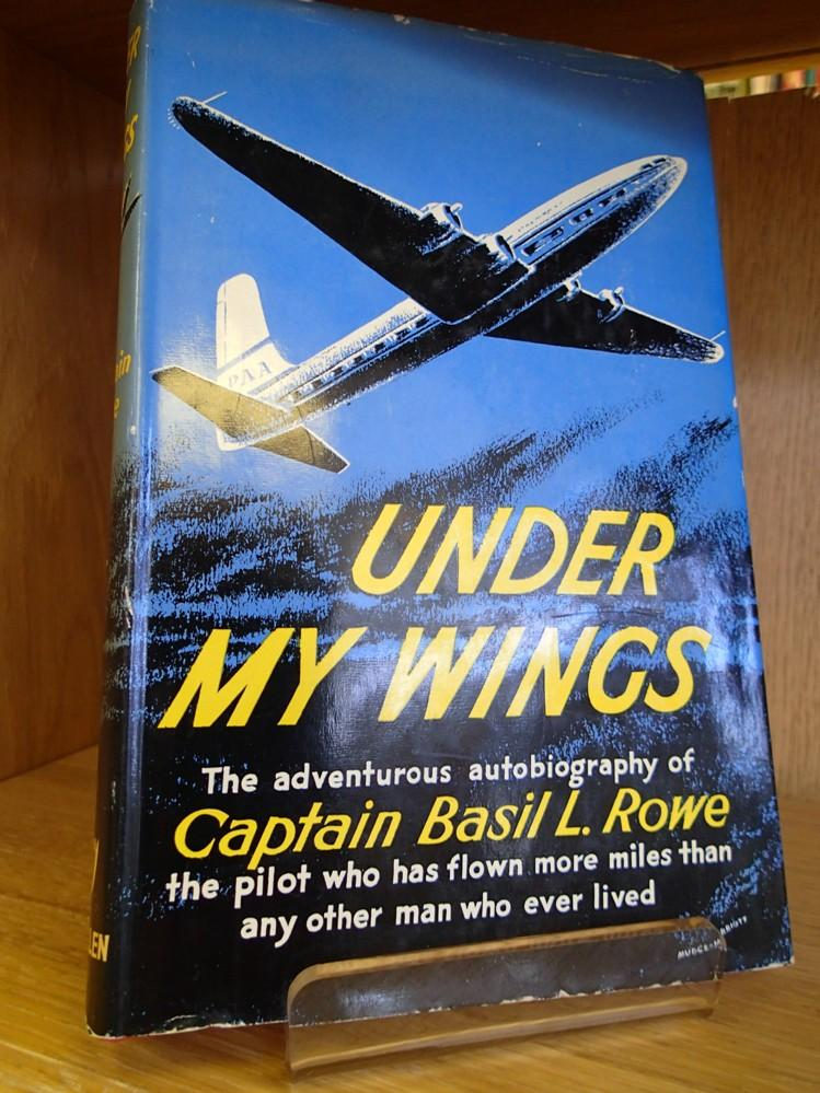 Under My Wings ROWE, Basil L Very Good Hardcover Red cloth boards with gilt lettering to spine. Boards are in very good order. No particular bumping or wear to corners or board edges. Spine is intact