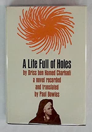 A Life Full of Holes (typed Letter laid in signed by Paul Bowles): Paul Bowles (Trans.) Driss ben ...