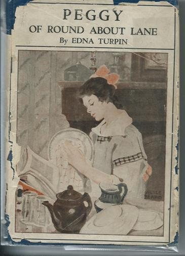 Peggy of Round About Lane Turpin, Edna Very Good Hardcover Used book. Blue hardback covers in pict d/w. 309pps. Girls story about the Callahan family, specifically Peggy, and her experiences caring for her sic
