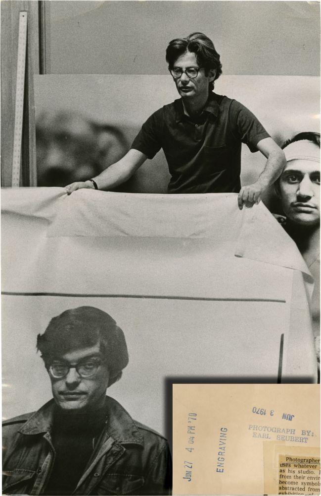 Richard Avedon holds up photograph of Rennie Davis (Original Chicago Tribune press photograph, 1970) Avedon, Richard (subject); Rennie Davis (subject