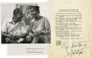 Photograph of Louis Armstrong with trumpet and with his wife, Lucille