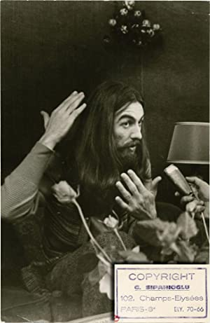 George Harrison at a press conference for