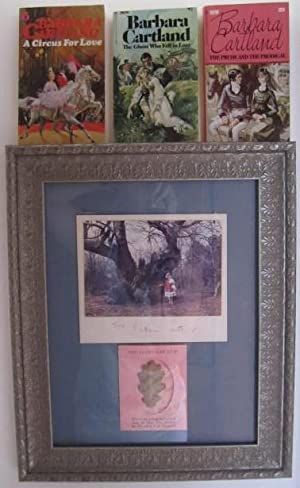 Framed photograph with Barbara Cartland's autograph, oak leaf from tree planted by Elizabeth I