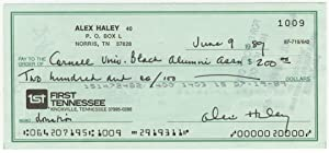 Alex Haley Signs Check to the Cornell University Black Alumni Association