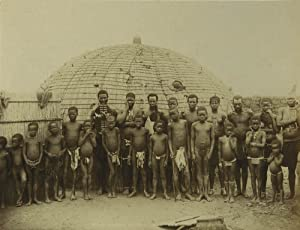 A Keshla and family. Titled in negative: A Policeman and Zulus in Kraal.: Photographer unknown].
