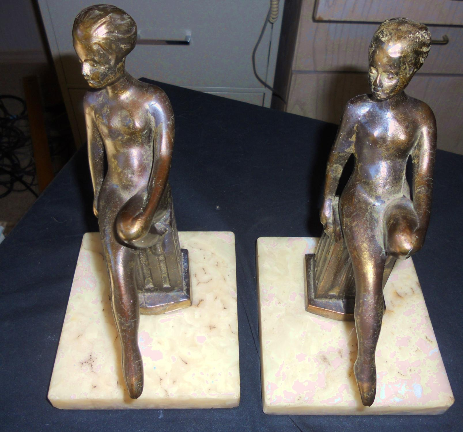ART DECO SEATED NUDE FEMALE BOOKENDS.