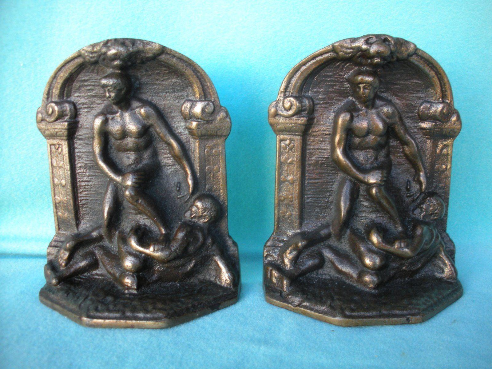 BOOKENDS: CAST IRON NUDE MALE WRESTLERS.
