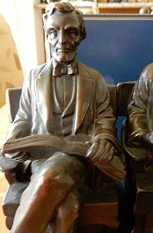 ABRAHAM LINCOLN, BRONZE CLAD BOOKENDS BY PAUL BENEDUCE.