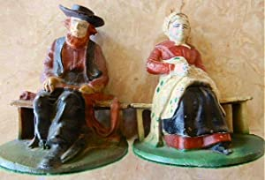 AMISH COUPLE CAST IRON BOOKENDS.