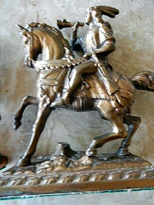 MAN AND WOMAN ON HORSEBACK. HEAVY METAL, COPPER COATED.