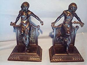 ART DECO BRONZED METAL BOOKENDS. TWO NUDE DANCING GIRLS. WITH SASH. $225.