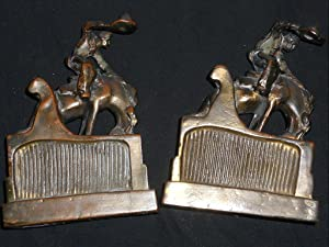 BOOKENDS: COWBOYS ON BUCKING HORSES, BRONZE FINISH.