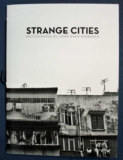 STRANGE CITIES. Photographs Brubaker, John Ryan Softcover Unpaginated, though 60 pp. 7  x 5-1/8  A haunting photo montage by Brubaker, who, using vintage Rangefinders, Polaroids and a Crown Graphic 4x5, captu